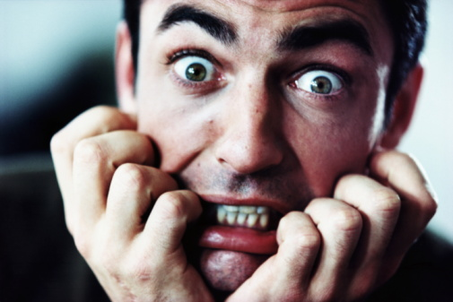 Man with scared expression, close-up
